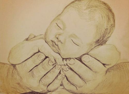 baby ligger i hender
